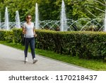 nordic walking   middle aged... | Shutterstock . vector #1170218437