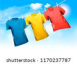 three t shirts hanging on rope... | Shutterstock .eps vector #1170237787