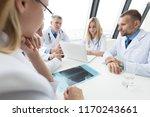 group of doctors look and... | Shutterstock . vector #1170243661