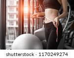 sporty woman using waist tape... | Shutterstock . vector #1170249274