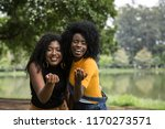 afro young friends having fun... | Shutterstock . vector #1170273571