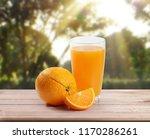orange  on white a wooden table | Shutterstock . vector #1170286261