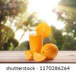 orange  on white a wooden table | Shutterstock . vector #1170286264