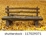 Wooden Bench In The Park On...