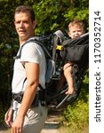 father on a walk with kik in... | Shutterstock . vector #1170352714