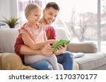 little girl with father doing... | Shutterstock . vector #1170370177