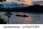 sunset on river and ship in... | Shutterstock . vector #1170372397