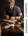 moustached footwear artisan... | Shutterstock . vector #1170400537