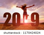 joyful girl jumping while the... | Shutterstock . vector #1170424024