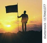 backlit image of man with flag...   Shutterstock . vector #1170461377