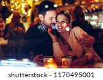 romantic couple dating in pub... | Shutterstock . vector #1170495001
