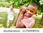 african boy with tin can... | Shutterstock . vector #1170498931