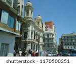 Small photo of Algiers, Algeria - Circa 2018. People walk on the street of west Algerian city Oran with background of various architectural buildings