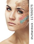woman with fantasy coloured powder on face on white background - stock photo
