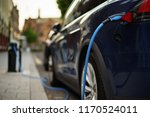 charging electric car on street | Shutterstock . vector #1170524011