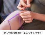detail shot of the hands and... | Shutterstock . vector #1170547954
