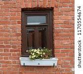 a window in a brick wall with... | Shutterstock . vector #1170554674