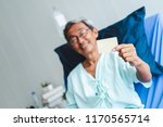 old asian patient man showing... | Shutterstock . vector #1170565714