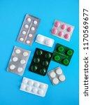 different pills on a blue... | Shutterstock . vector #1170569677