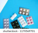 different pills on a blue... | Shutterstock . vector #1170569701