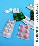 different pills on a blue... | Shutterstock . vector #1170569734