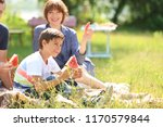 happy family eating watermelon... | Shutterstock . vector #1170579844