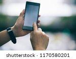 hands using martphone in modern ... | Shutterstock . vector #1170580201
