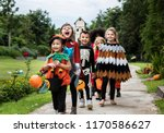 young kids trick or treating... | Shutterstock . vector #1170586627