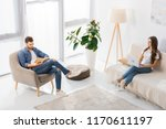 high angle view of woman using...   Shutterstock . vector #1170611197