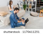 side view of smiling man using... | Shutterstock . vector #1170611251