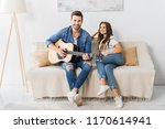 young man playing on acoustic...   Shutterstock . vector #1170614941