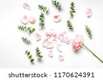 Stock photo woman table with flower and herbs top view white background patt 1170624391