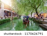 The watertown Tongli, the Venice of Asia, near Suzhou, Shanghai, China, with passing by Gondola on a canal