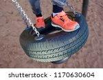 kid swinging at playground | Shutterstock . vector #1170630604