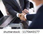 confident handshake of business ... | Shutterstock . vector #1170643177
