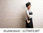 young baker indian woman... | Shutterstock . vector #1170651187
