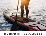 woman with a paddle on the... | Shutterstock . vector #1170651661