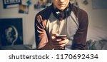 teenage boy in a bedroom... | Shutterstock . vector #1170692434