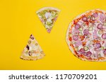 two pieces of pizza and pizza... | Shutterstock . vector #1170709201