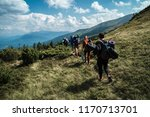 group of hikers walking on a... | Shutterstock . vector #1170713701