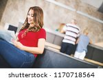 young female patient in a... | Shutterstock . vector #1170718564