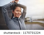 smiling young asian woman in... | Shutterstock . vector #1170731224