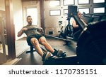 fit young man working out on a... | Shutterstock . vector #1170735151