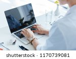 partial view of female doctor... | Shutterstock . vector #1170739081