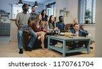 multi ethnic fans celebrate... | Shutterstock . vector #1170761704