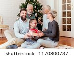 family gathered around a... | Shutterstock . vector #1170800737