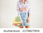 young woman in plaid shirt ... | Shutterstock . vector #1170827854