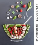vegetables falling into a bowl... | Shutterstock . vector #1170847654