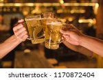 three friends toasting with... | Shutterstock . vector #1170872404