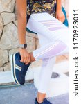latin woman working out in... | Shutterstock . vector #1170923011